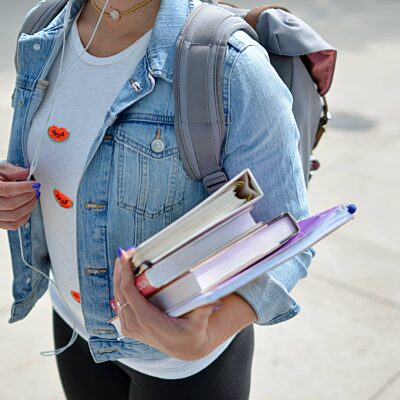 Student has books under her arm